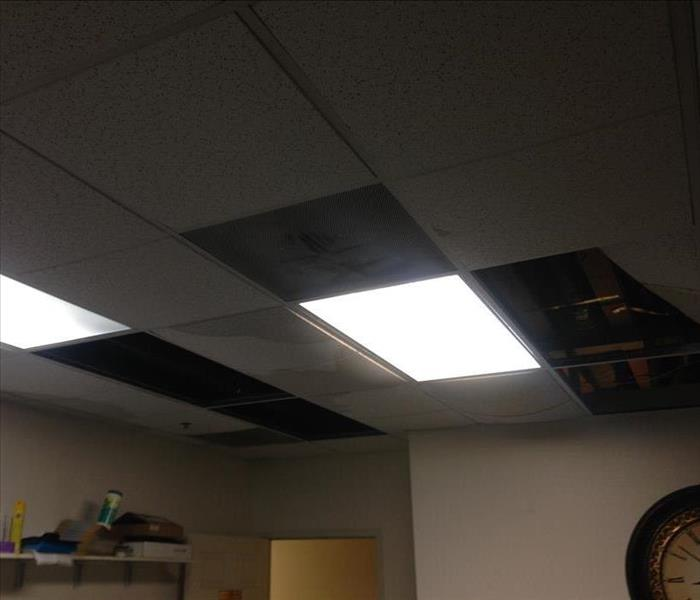 Ceiling collapsed from rain storm Before