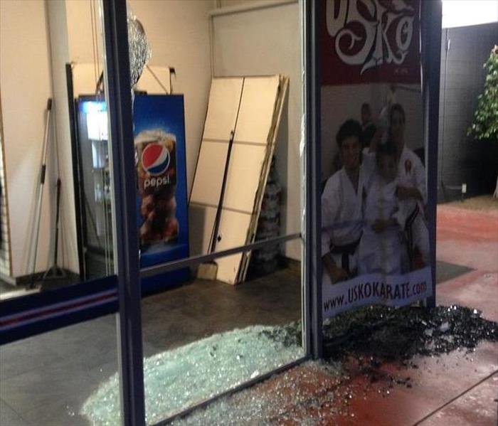 Car crashes into Store Front in Riverside, CA